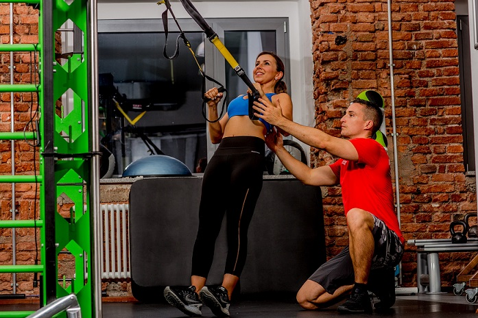 Personal Training in München - Rudern am TRX